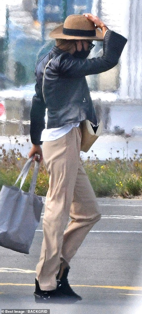 Nicole, 27, who has a seven-year-old son with her husband Mr Mary was seen at the airport following closely behind her companion, Pitt