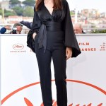 Monica Bellucci, 55, poses on a balcony ahead of attending Italian film festival