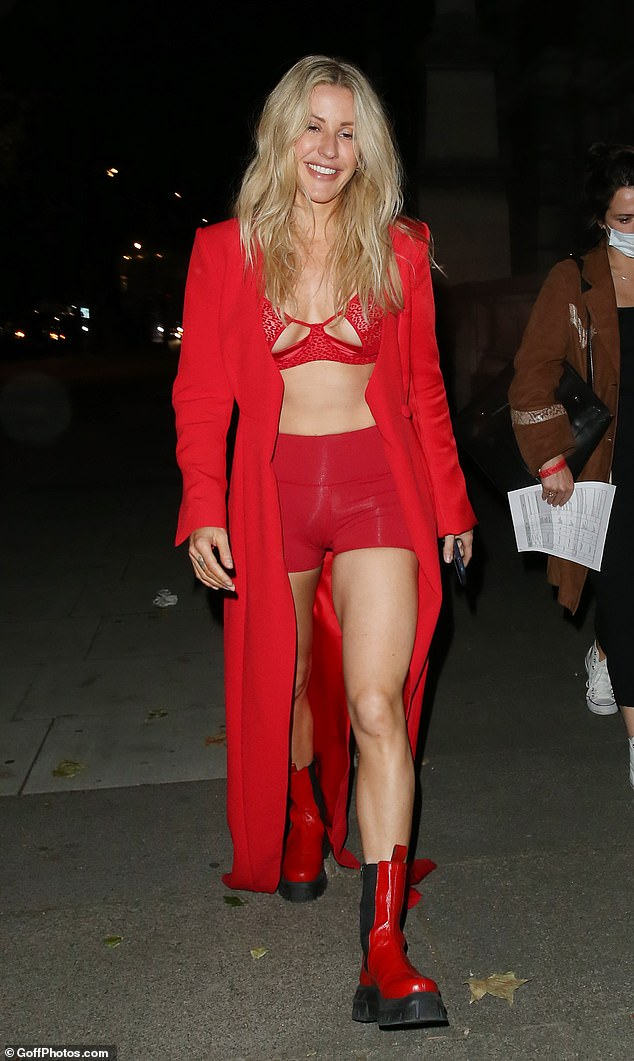 Red theme! Sticking to the red colour theme, the singer opted for knee-high chunky boots in the same shade as she made a glamorous exit from the V&A museum following her event