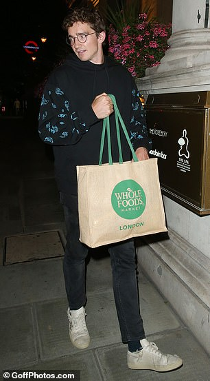 Exit: He carried a Whole Foods Market canvas bag