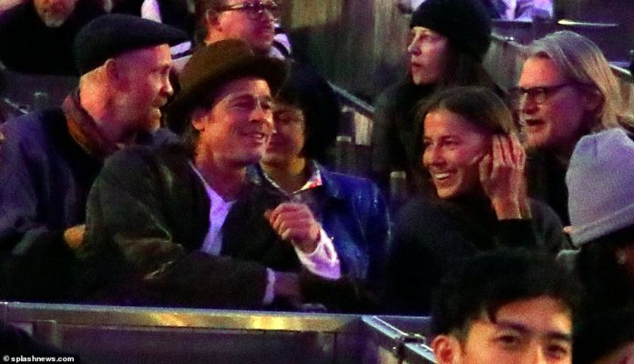 Cosy! Brad Pitt and German model and Angelina Jolie lookalike Nicole Poturalski have been pictured enjoying a cosy date night nine months ago, as their relationship was confirmed on Thursday
