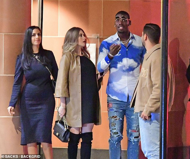 Paul Pogba (centre) has tested positive for coronavirus days after being pictured on a night out at a London restaurant with his pregnant wife Maria (left) and friends on Saturday