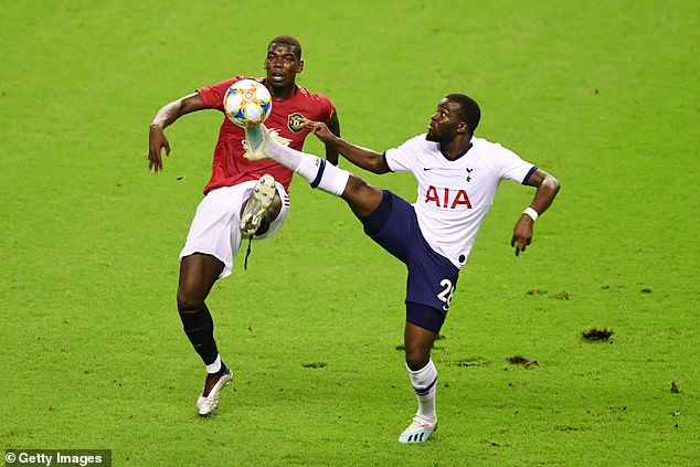 Pogba pictured playing against compatriot Tanguy Ndombele for United last year