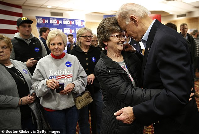 Joanne Rogers also defended Biden against accusations that he is too physical in his interactions with women. Biden has come under fire for several awkward and too-close-for-comfort physical interactions with women – oftentimes captured on camera. Biden is seen far right with supporters in Iowa in January 2020