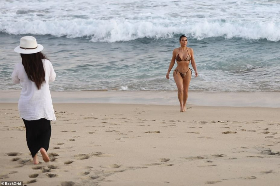 On the job: Her photoshoot was just a stone's throw away from the upscale beach house where she and sisters Khloe and Kourtney have been filming the next season of Keeping Up With The Kardashians with mom Kris