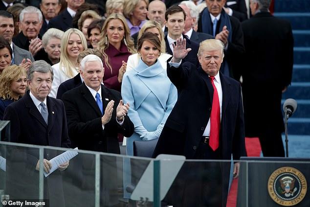 Ivanka Trump can be seen behind Melania Trump on the inaugural platform at the U.S. Capitol