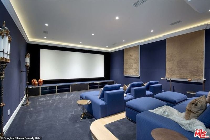Going to the pictures: Other amenities in the home include a screening room with comfy recliners for a movie night at home