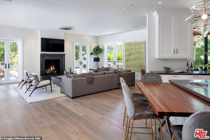 Elegant: The more open family room has its own fireplace and opens on the bar and the adjoining kitchen