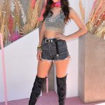 Victoria Justice showcases her toned figure in a bikini top and shorts outfit