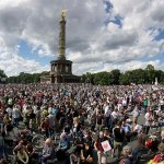 Thousands of anti-maskers who believe pandemic is a HOAX march against lockdown in London