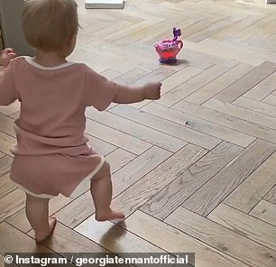 Tea time: In the video the actress, 35, filmed her 10-month-old as she excitedly walked towards a toy tea pot that had been placed on the floor