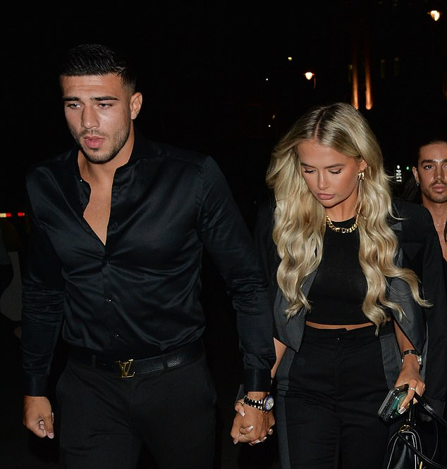 Dapper: Reality TV star Tommy's boyfriend, 21, looked dapper as he matched his girlfriend in an all-black skinny jeans set with a silk shirt and Louis Vuitton belt