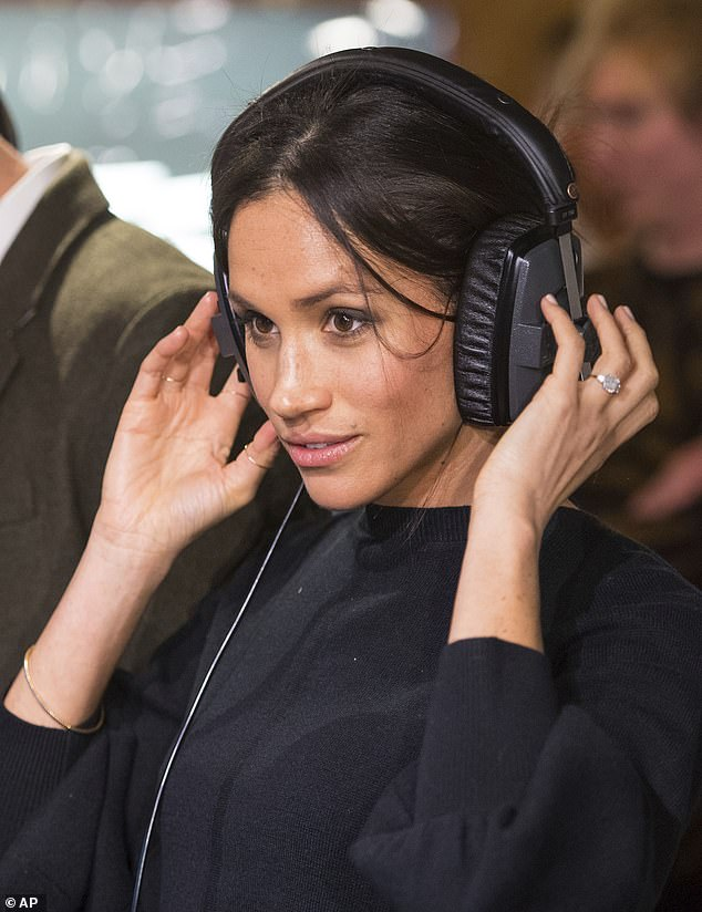 Sources said that money was 'not an item' for Spotify and Meghan would be able to more or less name its price. ''  Meghan is pictured during a visit to Reprezent 107.3 FM in Brixton in 2018