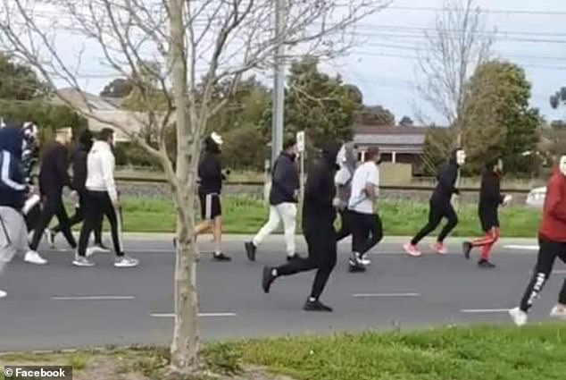 Confronting footage taken in Pascoe Vale, in Melbourne 's north, showed dozens of men dressed down in tracksuits and masks making their way through the streets as traffic was brought to a standstill