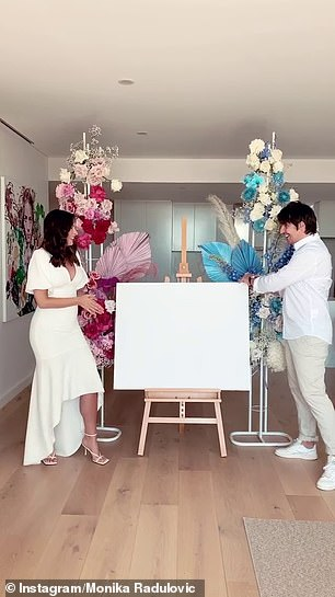 Baby reveal: Sharing a video to her Instagram account, the former Miss Universe Australia star revealed she was having a baby boy after unveiling blue ultrasound artwork