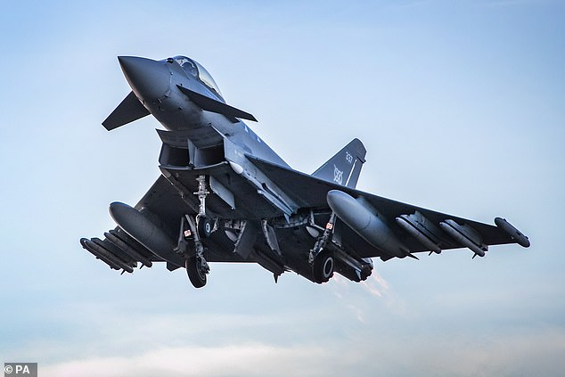 Two RAF Typhoon fighter jets were scrambled to escort a passenger jet at London Stansted Airport yesterday evening