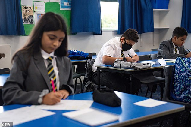 A poll found 88 per cent of staff said they lack confidence in the ability of the test and trace policy to make schools safe. Pictured, pupils return toManor High School in Leicestershire