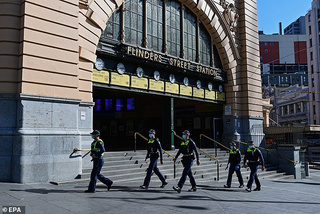 Police officers are seen outside Melbourne's Flinders Street station patrolling the city over the weekend