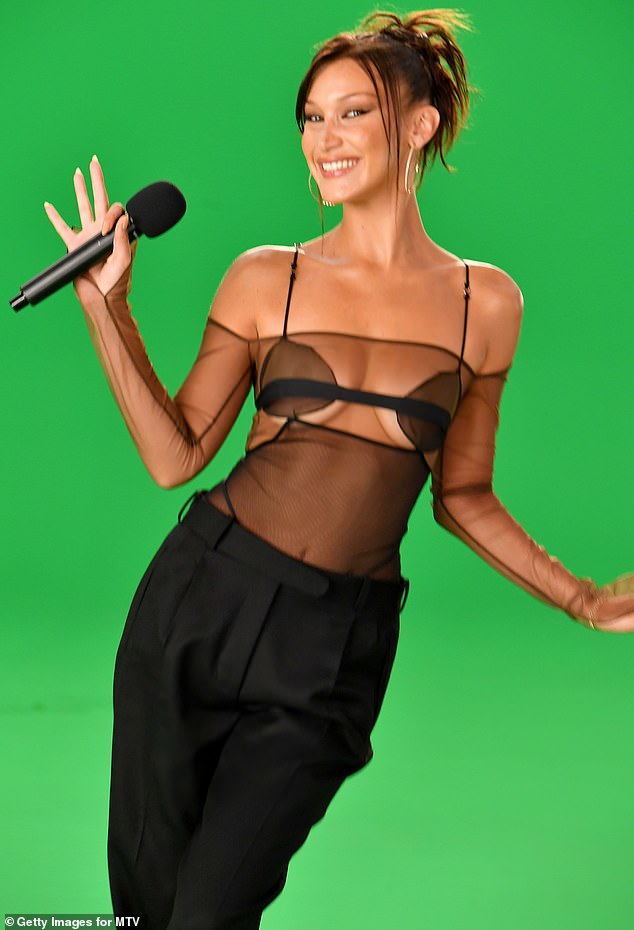 Make believe: The brunette beauty filmed her brief segment in front of a green screen, as this year's awards show took precautions against COVID-19, ditching the usual live audience format