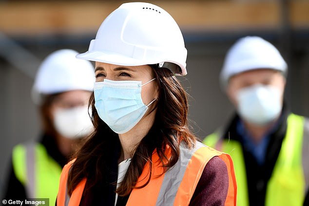Ms Ardern wears a mask during a visit to the Kainga Ora housing development on Monday