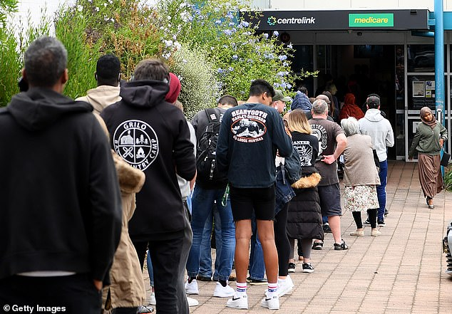 Mr Frydenberg said Victoria's unemployment rate before stage four lockdown in Jule sat about 10.5 per cent. He said it was about 8.5 per cent in NSW at the time. Pictured: People lining up at Centrelink in Flemington, Victoria, during the start of the coronavirus pandemic