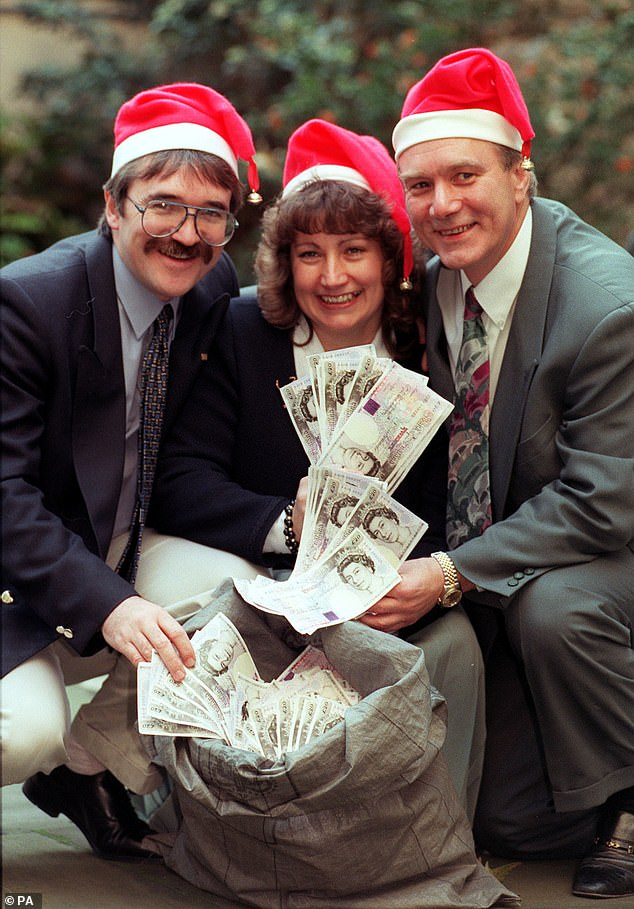 Pictured with her husband Derek and brother Ian after her win. Despite being vulnerable due to her asthma, she continued to work throughout the coronavirus lockdown