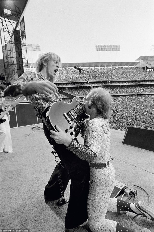 Thirteen rare vintage photographs from Terry's collection will go on display at London's Zebra One Gallery, including one of Elton John kissingDavey Johnstone's guitar during his show at the Dodger Stadium in Los Angeles, October 1975