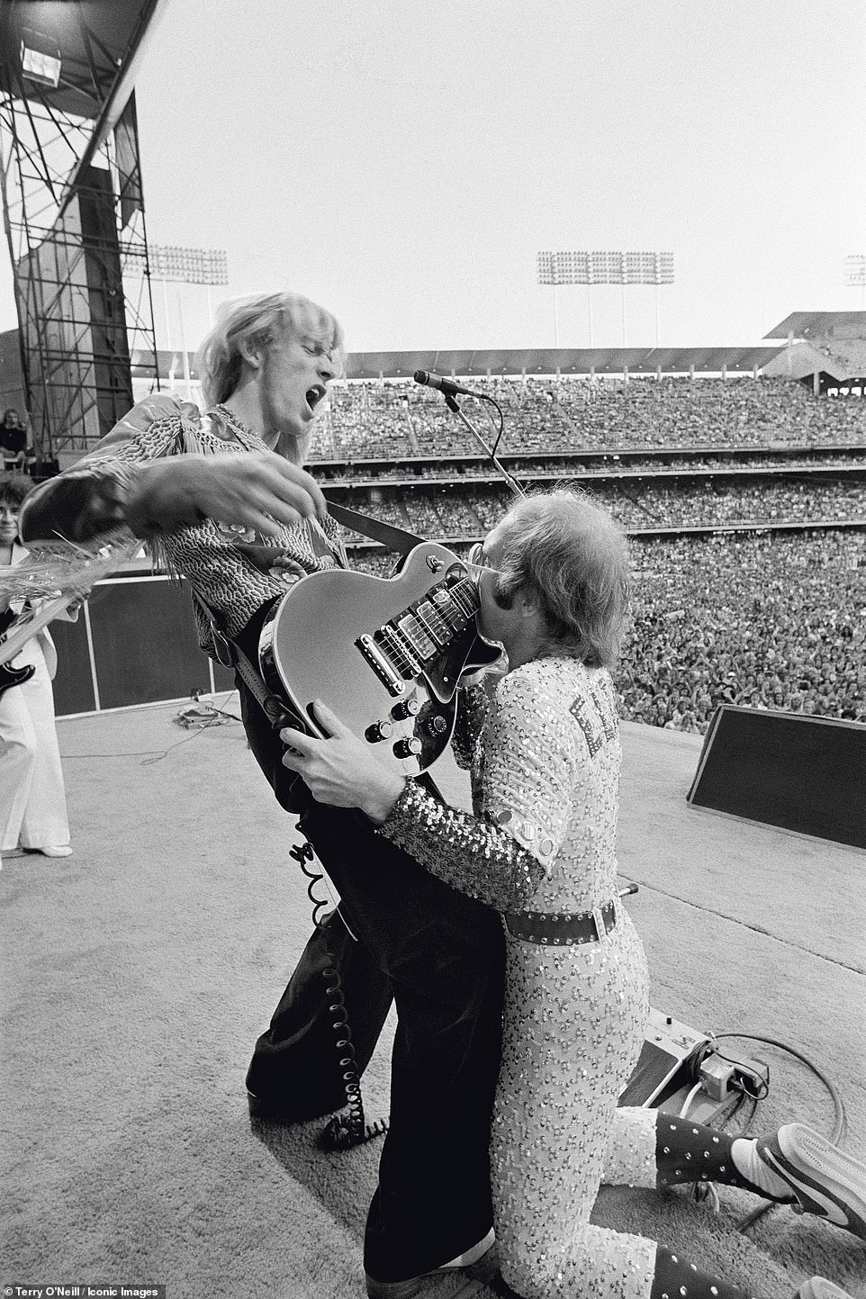 Thirteen rare vintage photographs from Terry's collection will go on display at London's Zebra One Gallery, including one of Elton John kissing  Davey Johnstone's guitar during his show at the Dodger Stadium in Los Angeles, October 1975