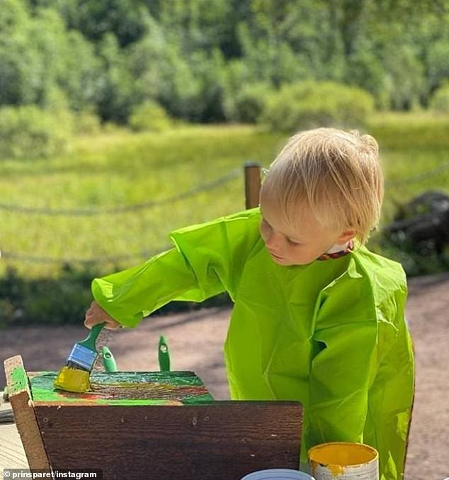'There is now also a birdhouse that Gabriel has painted,' the royal couple revealed, after sharing pictures of their son (pictured) enjoying his creative session at the nature reserve