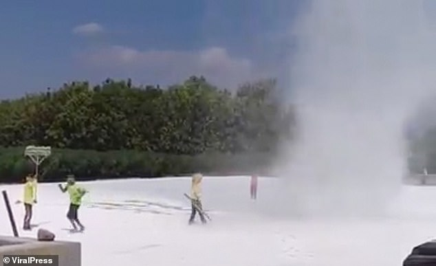 Dust devils also form on Earth. This is the moment a team of workers in Java, Indonesia, tried to 'kill' one with tools after it started wreaking havoc in the flour at a food processing plant