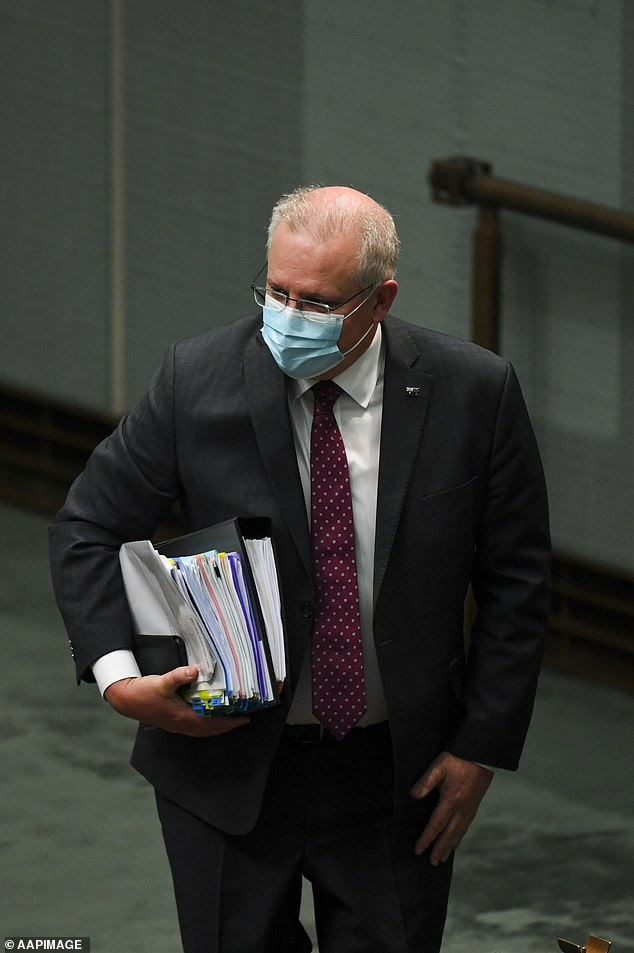 Prime MinisterScott Morrison (pictured in the House of Representatives on Monday) hopes Australia's state coronavirus restrictions should be lifted by Christmas