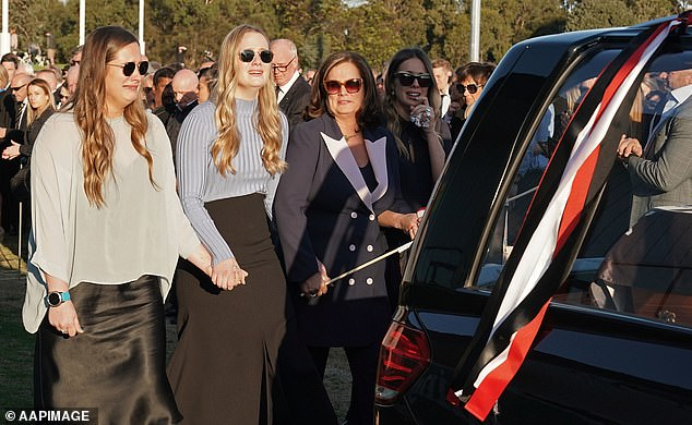 Daughters Chelsea, Keeley, Danielle Frawley and wife Anita Frawley follow the coffin of Danny Frawley at his funeral in September 2019