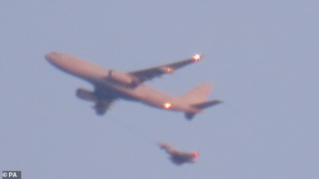 RAF Typhoon fighter escorting a Ryanair flight after a suspicious object was found aboard