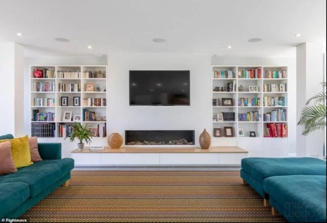 There is an open planned living area which features a plasma screen television and bookcases on either side.The property sold to new owners in 2012 and the breathtaking modern mansion is up for sale again for £3.4million