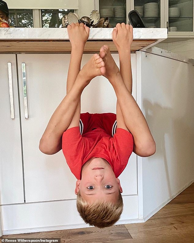 Funny: On Monday, however, it seemed that homeschooling had gone off the rails a little bit as she shared a series of snaps of Tennessee hanging upside down around the house