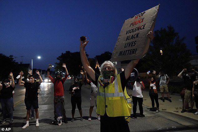 Rittenhouse had traveled from his Illinois home to Kenosha while protests were raging. Protesters are seen the night of the shooting on August 25