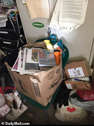 There was trash piled up, old porn memorabilia stuffed in overflowing boxes