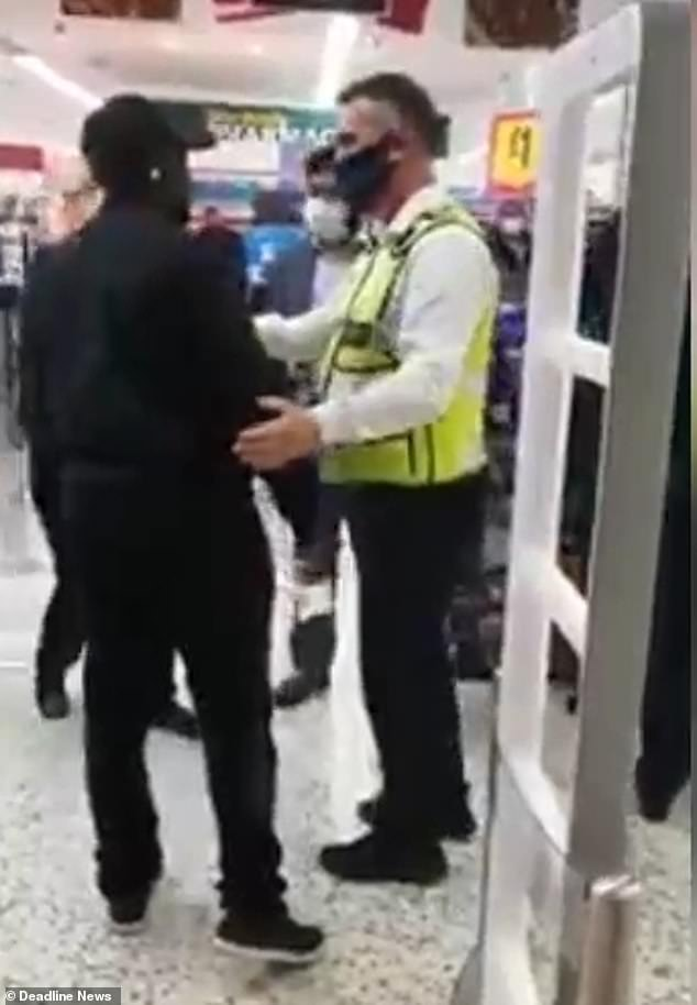 The client was held back by security telling the woman: 'They are going to have to fire you'