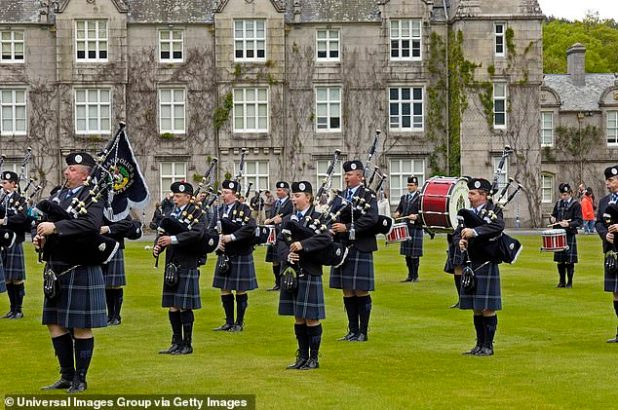 The Grampian Police Pipe Band is depicted at Balmoral Castle, Scotland