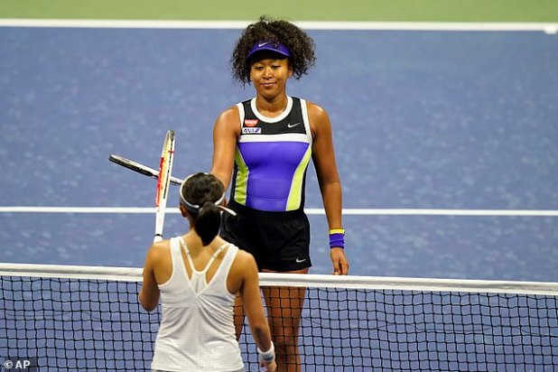 She taps the racket with Doo after beating him in three sets a day at Flushing Meadows