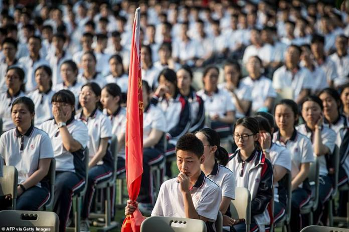 State media have released images of thousands of students hoisting the Chinese flag - a daily routine in all public schools - despite warnings to avoid mass gatherings.  Students attend the 100th anniversary of the founding of Wuhan High School on the first day of the new semester in Wuhan in central China's Hubei Province on Tuesday, September 1