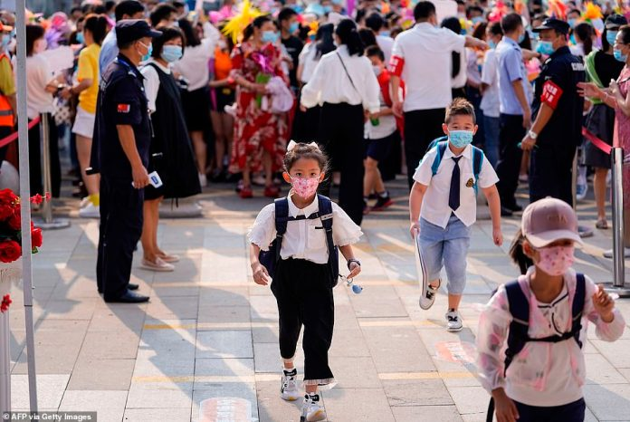 Nearly 3,000 schools and kindergartens in Wuhan will reopen to nearly 1.4 million students as of Tuesday.  Elementary students arrive at school on the first day of the new semester in Wuhan, central China's Hubei Province, September 1