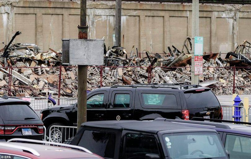 President Donald Trump's motorcade drives by wreckage in Kenosha, Wisconsin