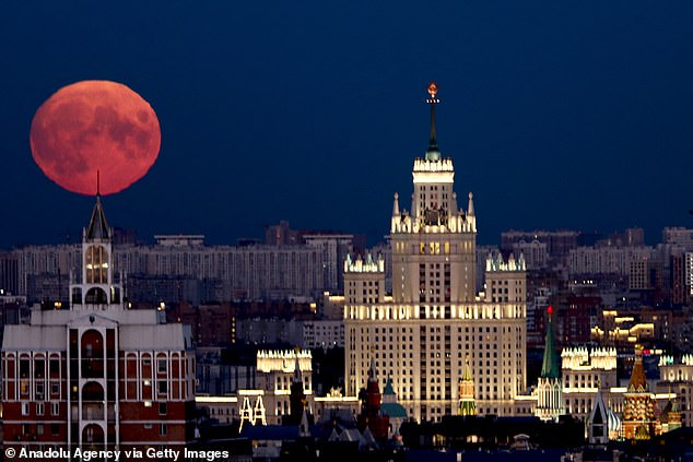 The last full moon of the summer is set to appear in the night sky across the US Tuesday. Pictured is the eventover Red Square in the capital city Moscow, Russia on September 01, 2020