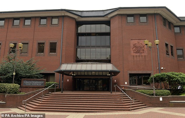The second day of the 17-year-old's trial at Birmingham Crown Court (pictured) got underway today. Prosecutor Matthew Brook describedFeuerkrieg Division (FKD) as: 'A group that believes violence - and in particular mass shootings - are good'