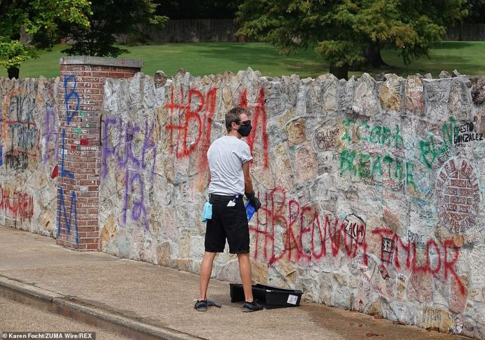 The spray painted lettering covered thousands of tributes to Elvis written by fans who have visited the King's House since it officially became a museum in 1982.