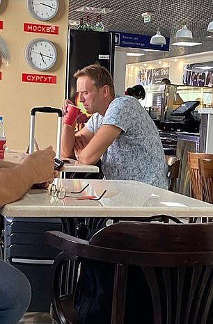 Navalny fell ill on a plane following a trip to an airport cafe (pictured) where his friends suspect he could have been poisoned