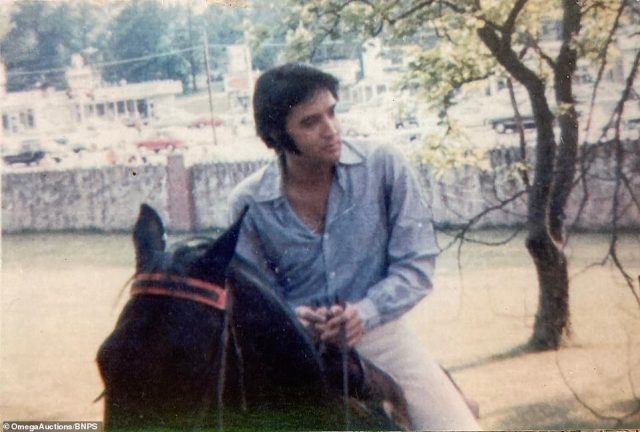 Four of the eight images going up for auction this month show Elvis Presley riding a horse on his ranch in Memphis which are understood to have been taken by an associate of his and have only been viewed by a handful of hardcore Elvis fans