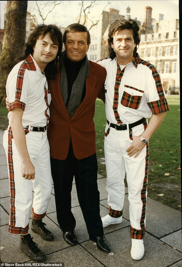 Tony Blackburn (center) with Les Mckeown (right) and Ian Mitchell (left) of The Bay City Rollers