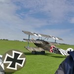 WWI replica British biplane crashes during mock dogfight with German aircraft at aerodrome